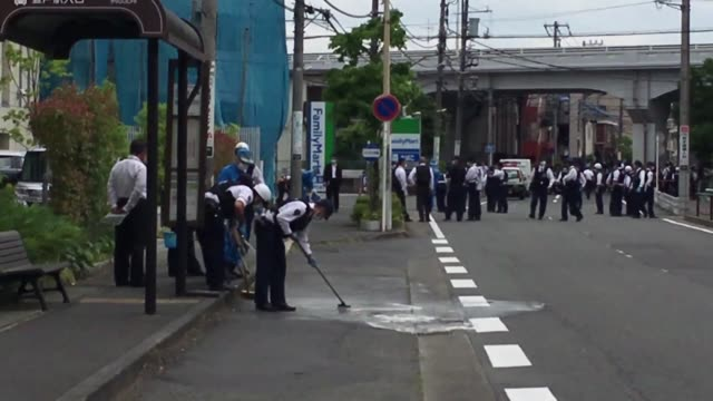 japanese firemen and police forensic experts gather at the site where a knife wielding attacker killed a 12 year old schoolgirl and another man... - dozen stock videos & royalty-free footage
