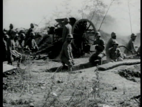 japanese firing artillery. smoke rising from bombed chinese building. japanese firing another artillery gun. nationalist chinese behind barricade... - barricade stock videos & royalty-free footage