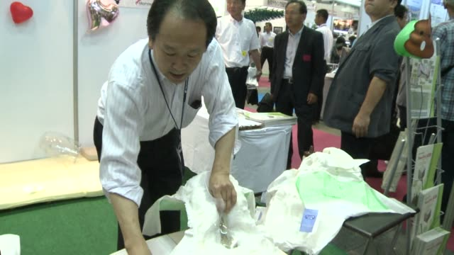 japanese firms showcased incontinence devices that combine a diaper with a personal bidet just one of many inventions on display at a tokyo... - incontinence stock videos and b-roll footage