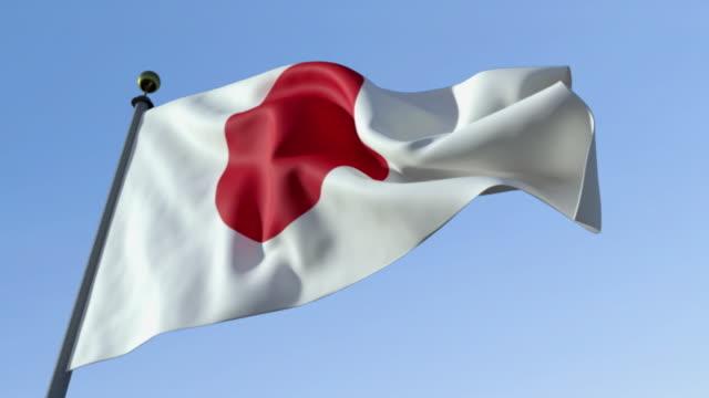 cu, la, japanese flag blowing against blue background - japan flag stock videos & royalty-free footage