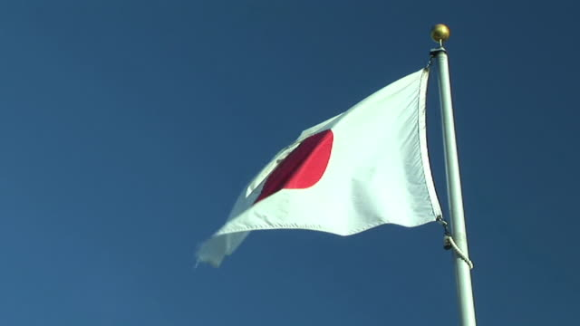 ms, japanese flag flapping against clear sky - japan flag stock videos & royalty-free footage