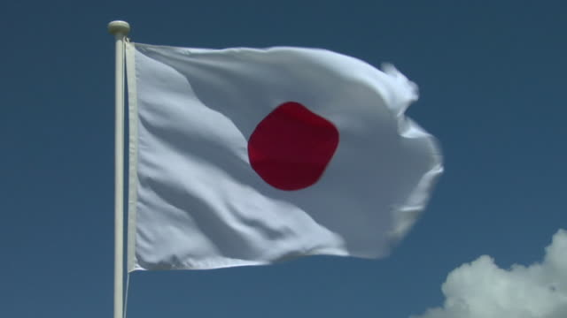 cu, japanese flag flapping against sky - japan flag stock videos & royalty-free footage