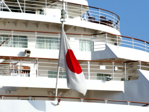 ntsc: japanese flag in the stern of cruise ship (video) - japan flag stock videos & royalty-free footage