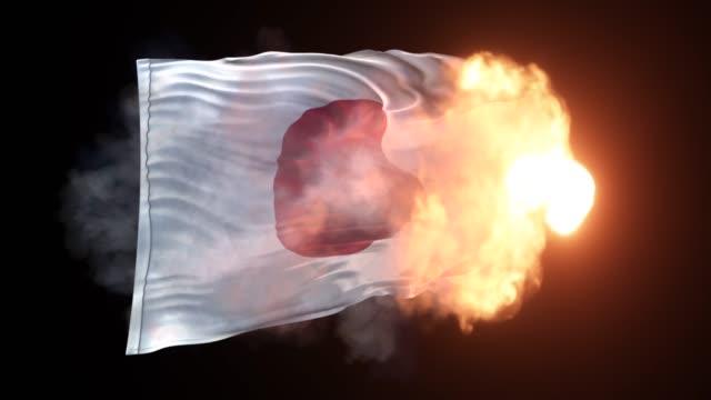 4k解像度で黒い背景に炎と波に日本の旗が登場しています - 戦争点の映像素材/bロール