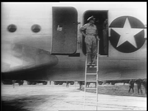 a japanese flag lowers a us flag raises / atsugi air base the plane 'bataan' lands and general douglas macarthur climbs down a ladder / soldiers rush... - general macarthur stock videos & royalty-free footage