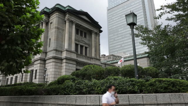 japanese flag waving in front of bank of japan headquarters in tokyo, japan, on monday, september 14, 2020. - japan flag stock videos & royalty-free footage