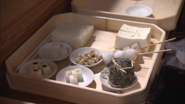 japanese food on a wooden tray in shiga prefecture, japan - 盆点の映像素材/bロール