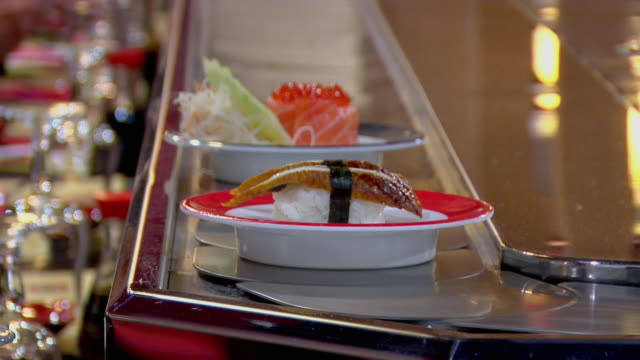 CU TS Japanese food sliding on line in restaurant, Rome, Lazio, Italy