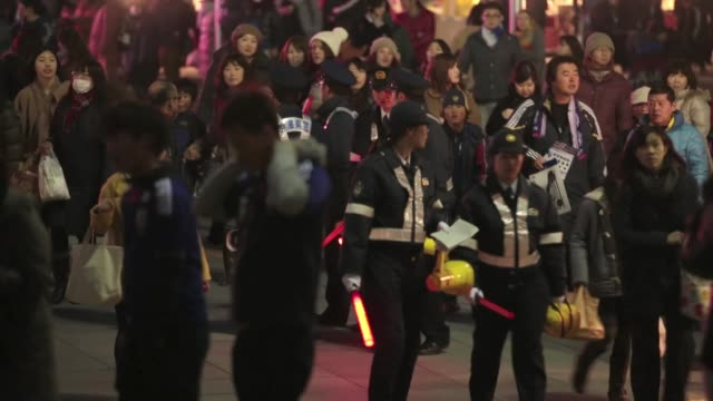 japanese football fans arrive for the international friendly match between japan and latvia at home's stadium kobe on february 6 2013 in kobe japan... - international match stock videos & royalty-free footage