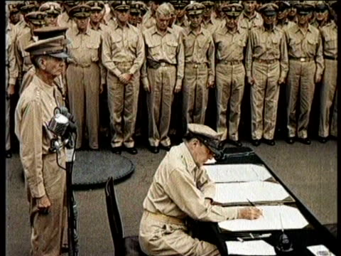 japanese foreign minister boards the battleship / he sits at a table / he removes his and white gloves / he signs a document / macarthur watches /... - general macarthur stock videos & royalty-free footage