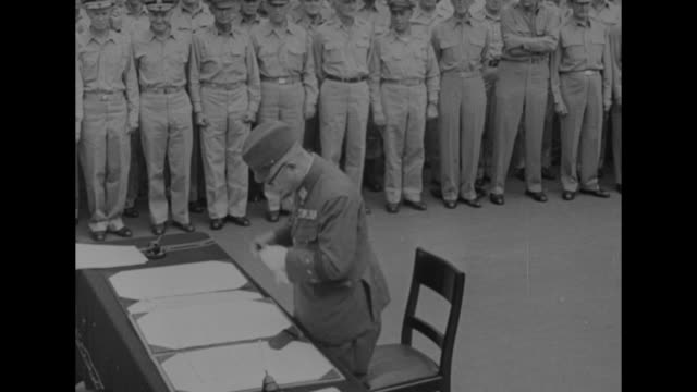 japanese foreign minister namoru shigemitsu walks up to table on deck of ship / as he sits at table assistant shows him surrender documents / two... - surrendering stock videos & royalty-free footage