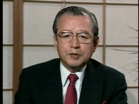 japanese foreign ministry spokesman taizo watanabe discusses japan's role in the persian gulf war. - (war or terrorism or election or government or illness or news event or speech or politics or politician or conflict or military or extreme weather or business or economy) and not usa点の映像素材/bロール