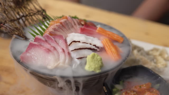 japanese fresh sashimi fish and seafood set with dry ice. - appetizer stock videos & royalty-free footage