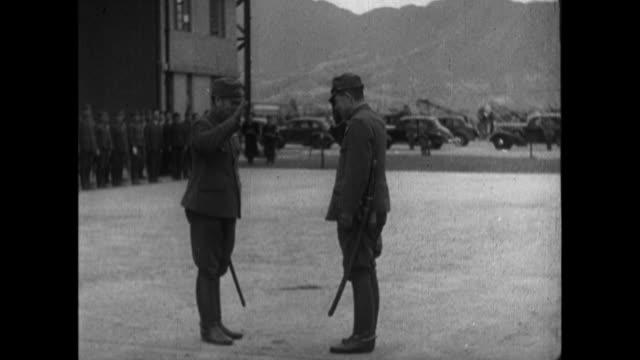 japanese general rensuke isogai arrives at hong kong's kai tak airport and meets highest army officer of hong kong command takashi sakai general... - japanese military stock videos & royalty-free footage