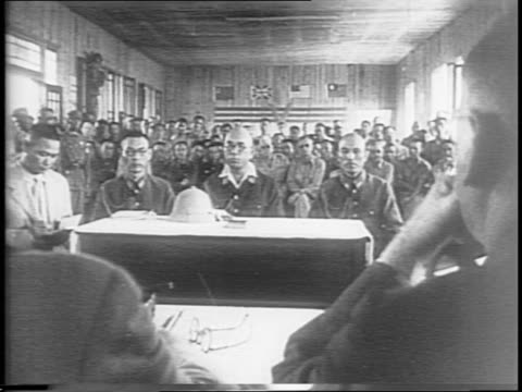 Japanese generals and politicians formally surrender to several Chinese generals and politicians / Japanese officials including General Takeo Imai...