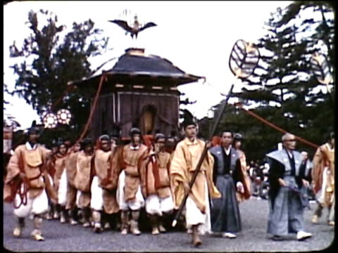 1963 montage japanese gion festival with participants in traditional dress / japan - large group of animals点の映像素材/bロール