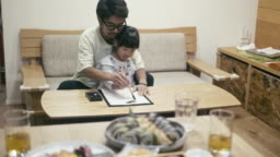 Japanese girl doing Japanese calligraphy on New Year's Day
