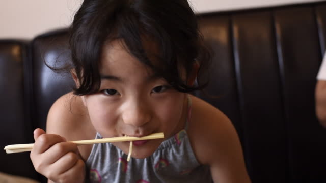 japanese girl eating noodle - eating utensil stock videos & royalty-free footage