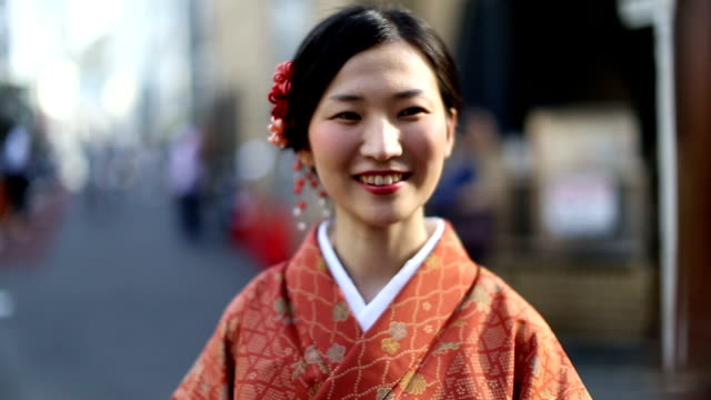 Japanese Girl in a Kimono Laughing and Smiling in Shibuya
