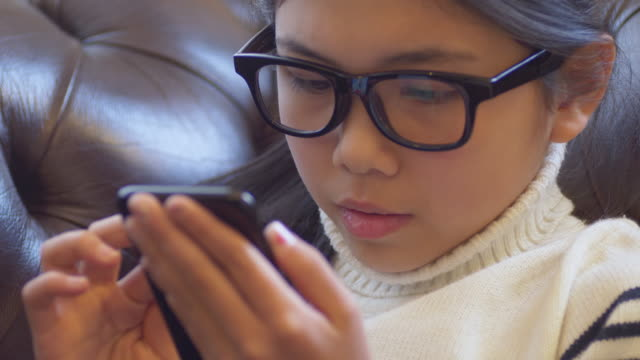 Japanese Girl using smart phone .