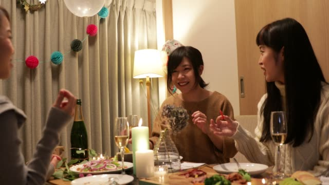 japanese girls enjoying christmas dishes - dinner party stock videos & royalty-free footage