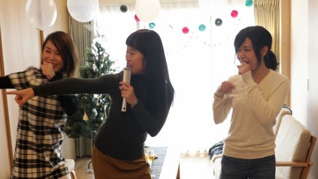japanese girls enjoying karaoke - curiosity stock videos & royalty-free footage
