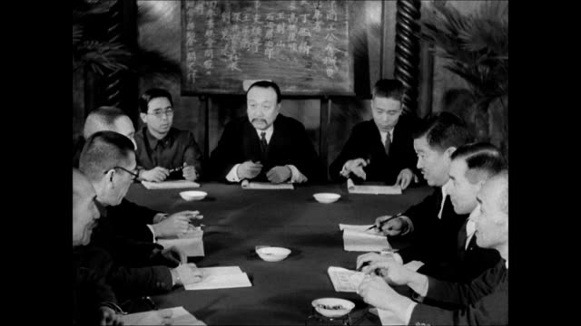 japanese government building. int vs japanese business men in meeting around table. ext chinese coolies working on railroad tracks train passing bg.... - prisoner of war stock videos & royalty-free footage