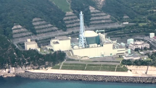 japanese government officials entered into final deliberations concerning the fate of the troubleprone monju prototype fastbreeder nuclear reactor at... - nuclear energy stock videos & royalty-free footage