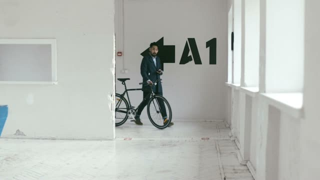 Japanese Graphic Designer coming to work with bike (slow motion)