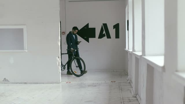 japanese graphic designer coming to work with bike (slow motion) - freelance work stock videos and b-roll footage