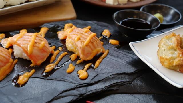 japanese gyoza on plate - savoury sauce stock videos & royalty-free footage