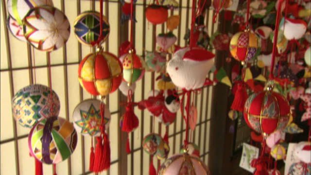 Japanese hanging dolls represent fanciful shapes and creatures.