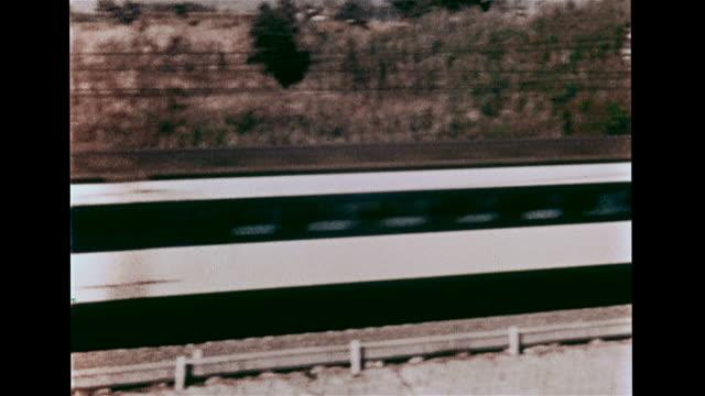 japanese high speed dangan ressha moving rapidly west on rural track, xws mount fuji, shinkansen railroad tracks, train speeding ino frame & east on... - high speed train stock videos & royalty-free footage