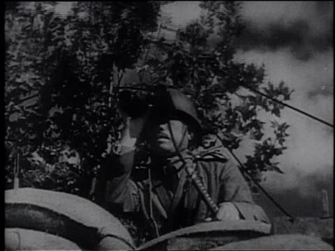 japanese infantry advancing carrying a flag / smoke from shelling in a field / japanese soldier looking through binoculars / japanese troops in the... - frank capra video stock e b–roll