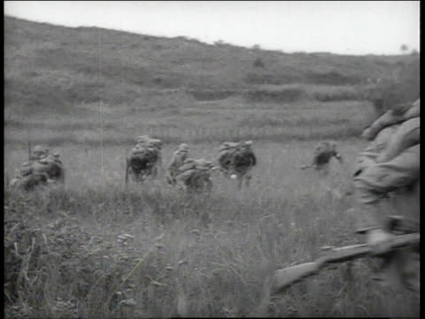 japanese infantry crouching in grass, holding guns, standing up, and running / china - infantry stock videos & royalty-free footage