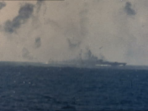 japanese kamikaze diving at us battleship / striking ship / explosion in water in foreground - marina personale militare video stock e b–roll