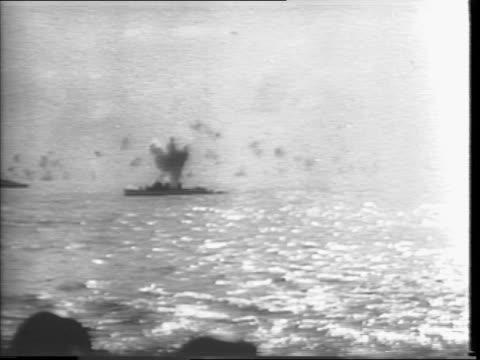 Japanese kamikaze planes in air / guns aboard carrier / guns fired from ship / carrier / guns firing at Japanese planes / Japanese plane in air being...