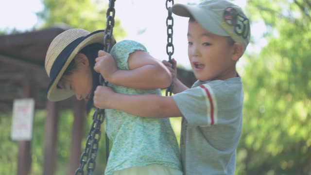 Japanese kids having fun in the park.