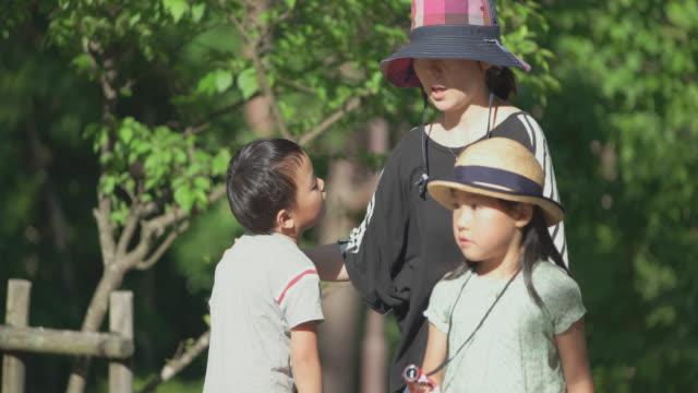 Japanese kids having fun in the park.
