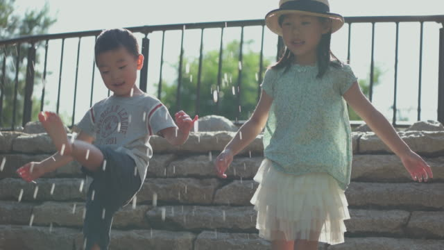 japanese kids having fun in the park. - natural parkland stock videos & royalty-free footage