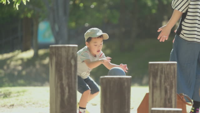japanese kids having fun with  his mother in the park. - childhood stock videos & royalty-free footage