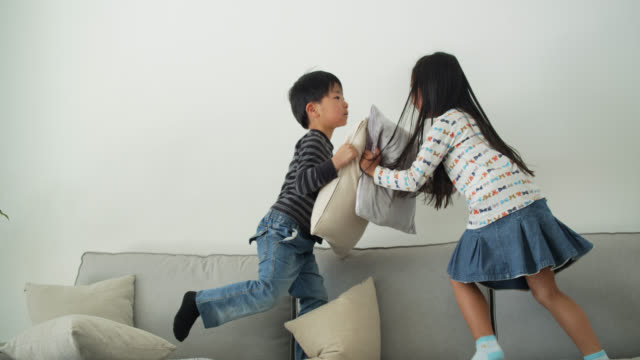 japanese kids having pillow fight - pillow fight stock videos & royalty-free footage