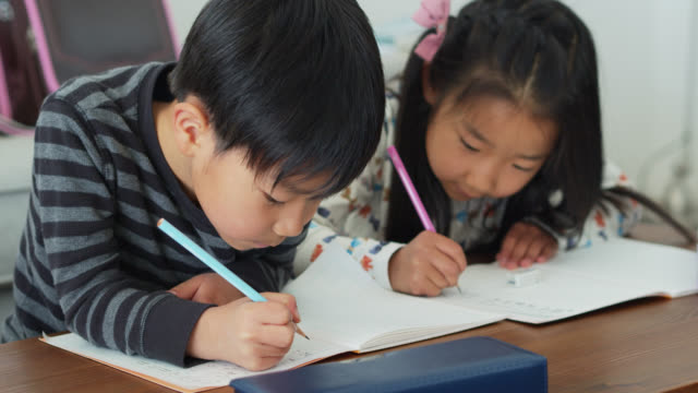 japanese kids learning to write - brother stock videos & royalty-free footage