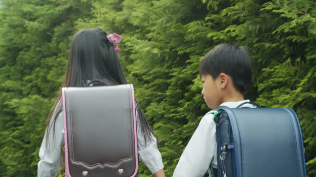 japanese kids walking home from school - japanese school uniform stock videos & royalty-free footage