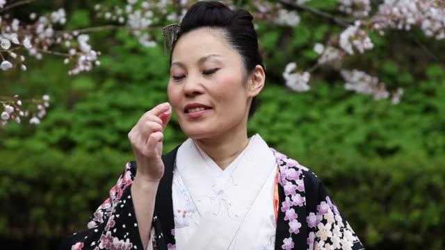 Japanese Kimono Woman Eating Candy