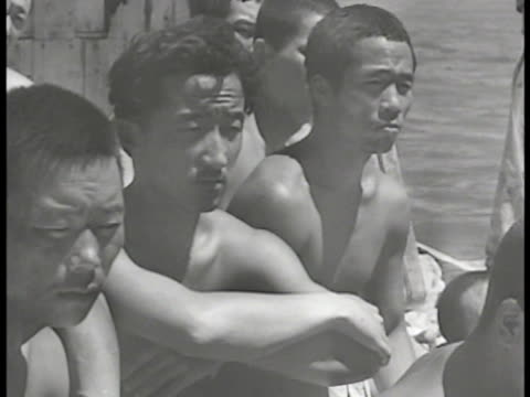 Japanese Korean prisoners SOFT FOCUS POWs washing in water by beach