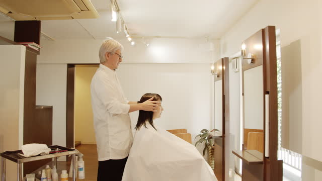 japanese male hairdresser trims wet hair of japanese woman at hairdresser - wet hair stock videos & royalty-free footage