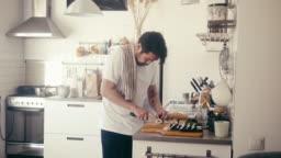 Japanese man cutting maki sushi (slow motion)
