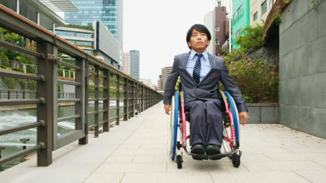 japanese man in a wheelchair - accessibility stock videos & royalty-free footage