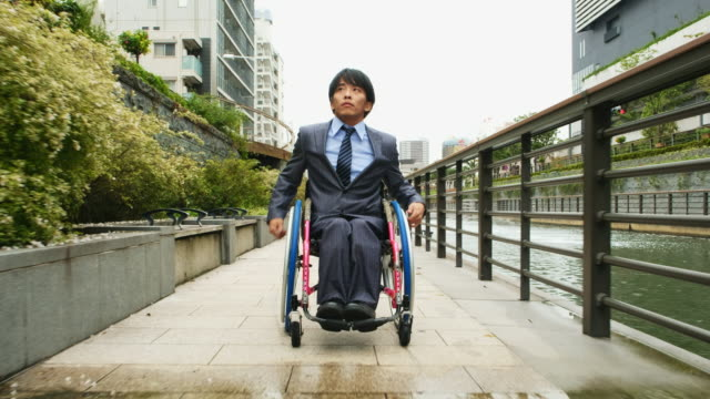 japanese man in a wheelchair - persons with disabilities stock videos & royalty-free footage